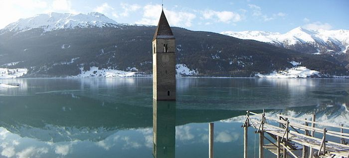 Weird Italy 004CampanileCuron Surreal Places: the old bell tower of submerged Curon Italian History Magazine What to see in Italy  Val Venosta trentino alto adige submerged ghost town semi submerged bell Rio Carlino Mittersee lake resia Josef Duile Curon Graun Curon Venosta curon bell tower of curon bell tower
