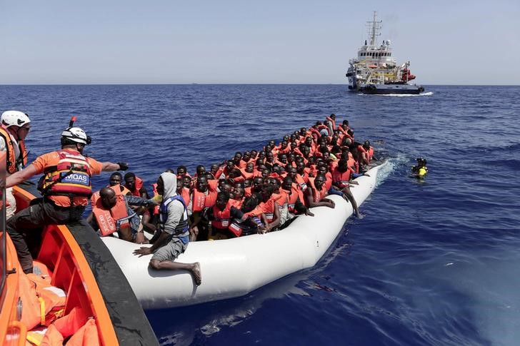 Weird Italy 2016-09-05T115357Z_1_LYNXNPEC840N2_RTROPTP_3_OZATP-UK-EUROPE-MIGRANTS-ITALY Italy rescues 500 boat migrants, six bodies off Libya Latest Italian News and Videos  survivors migrants Libya Italian navy Italian aircraft carrier Garibaldi