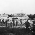 Troops from 51st Highland Division unloading stores from tank landing craft on the opening day of the Allied invasion of Sicily, 10 July 1943